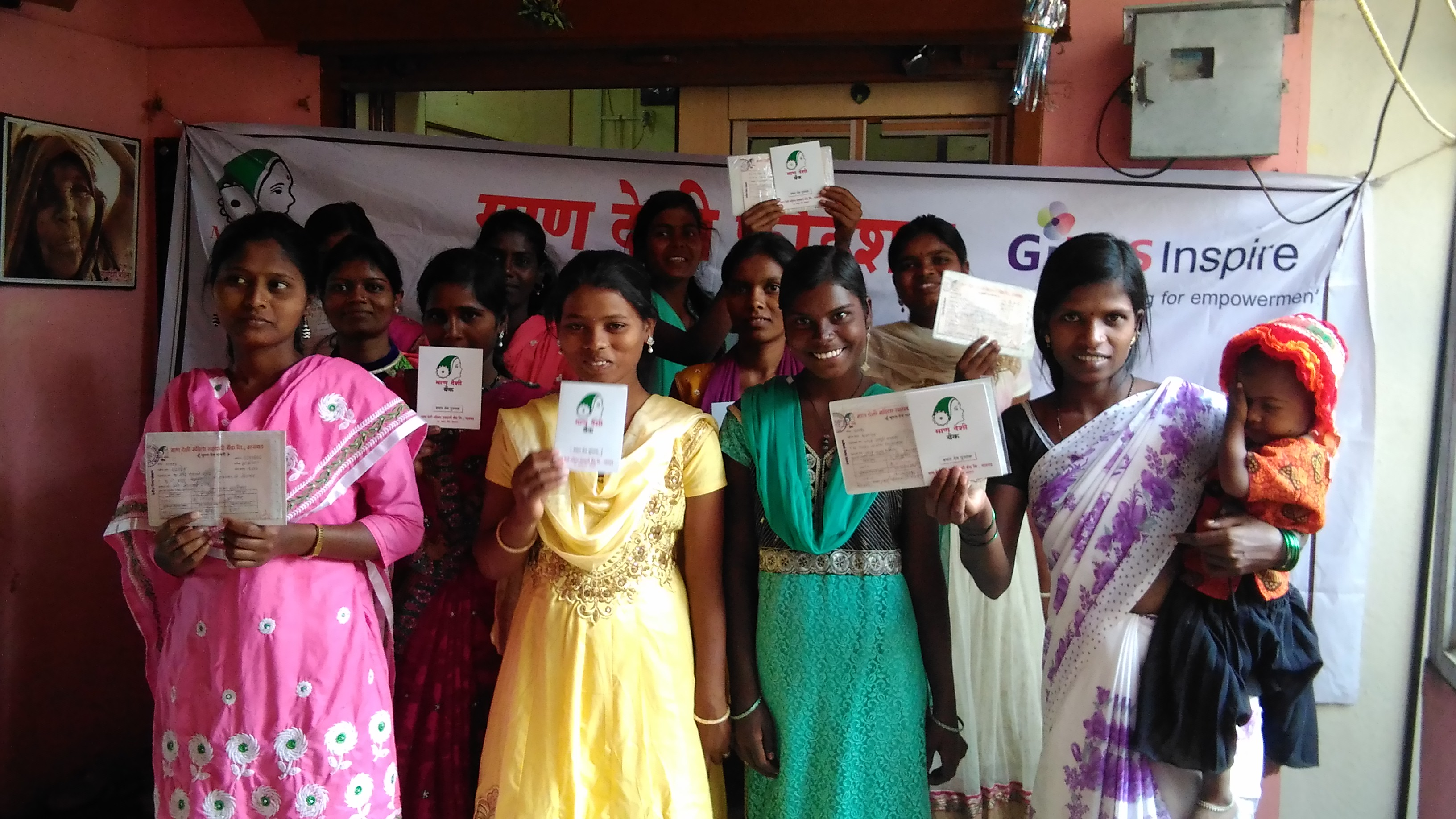 Girls receiving bank accounts in India, with Mann Deshi.